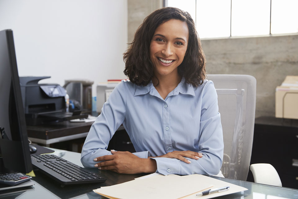 happy woman working at desk