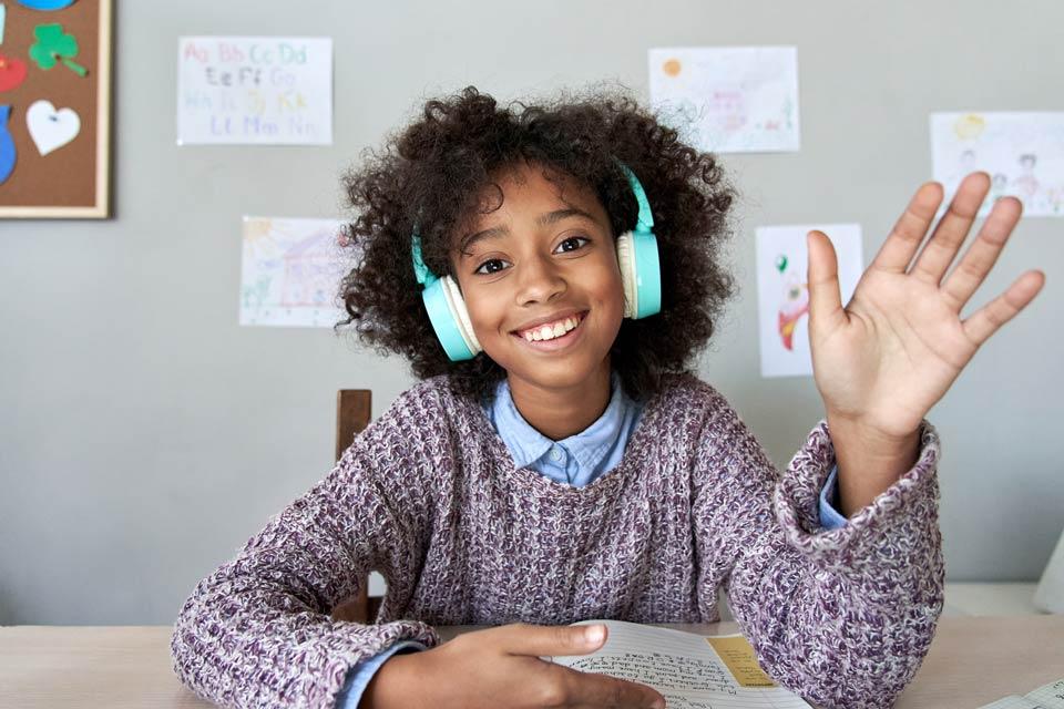child smiling wearing headphones